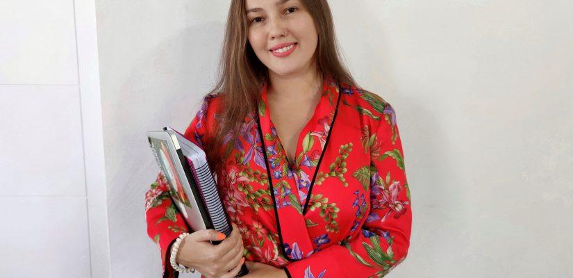Student Polina Akzhigitova holding papers