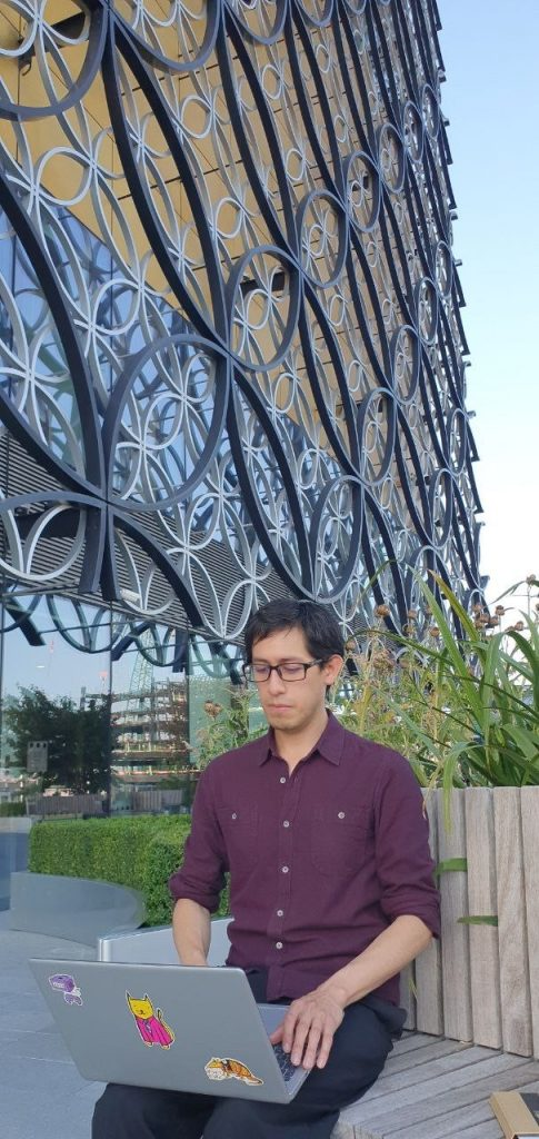 Rene sitting in front of Birmingham Library